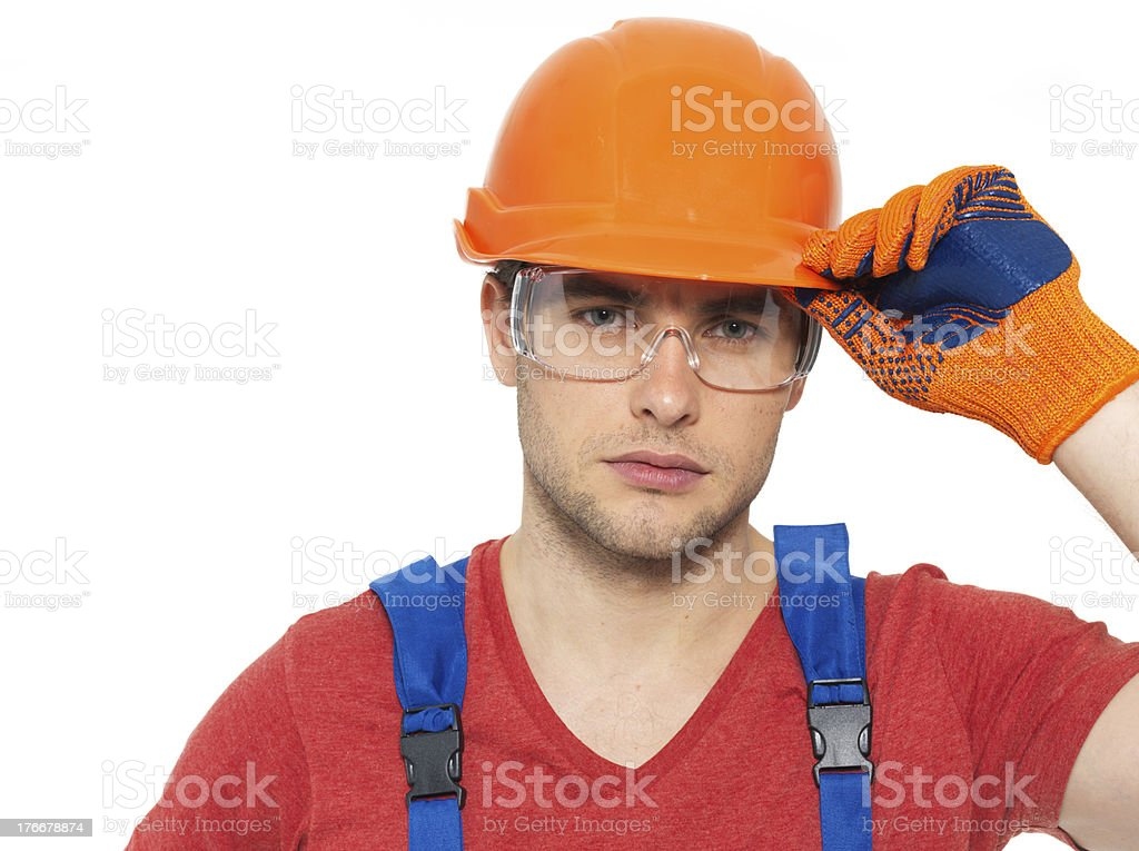 portrait of thinking handyman in uniform royalty-free stock photo