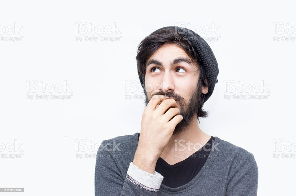 Portrait of thinking young man looking up in thoughts stock photo