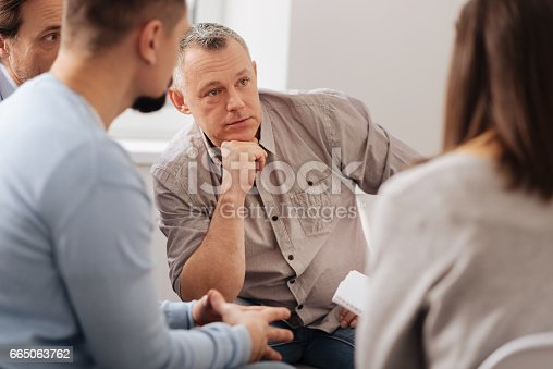 istock Portrait of thoughtful man that leaning on his fist 665063762