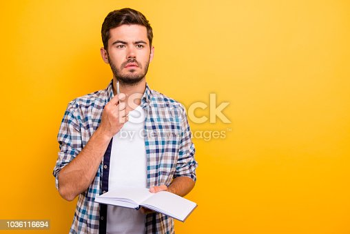 926239360 istock photo Portrait of thoughtful, serious, bearded man holding copybook is 1036116694