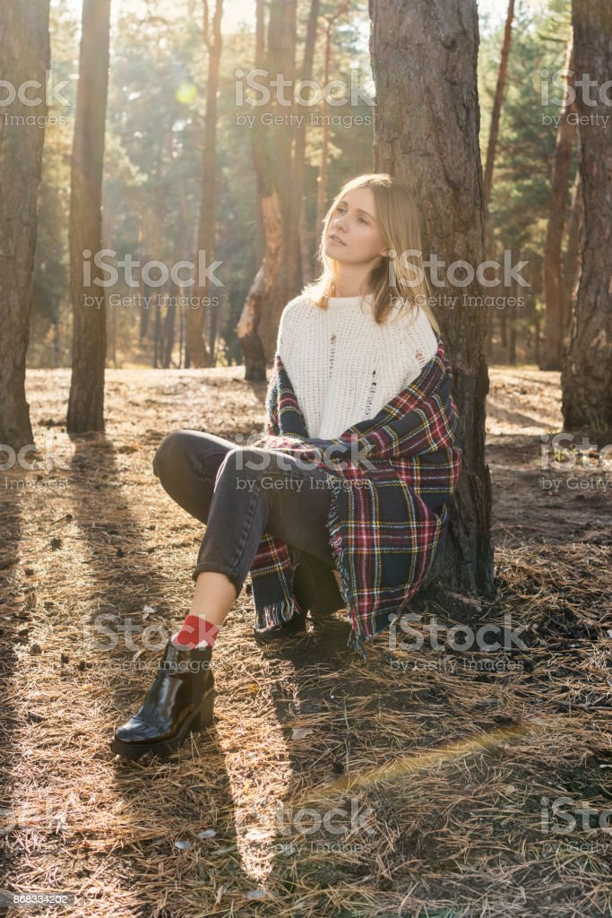 Portrait of thoughtful woman in a forest stock photo