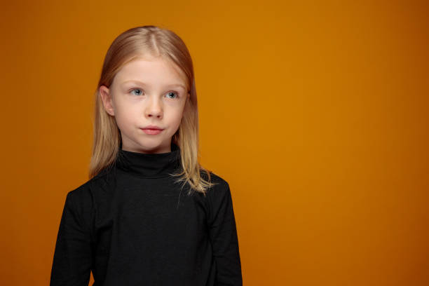 portrait of thoughtful young girl with blond long hair stock photo