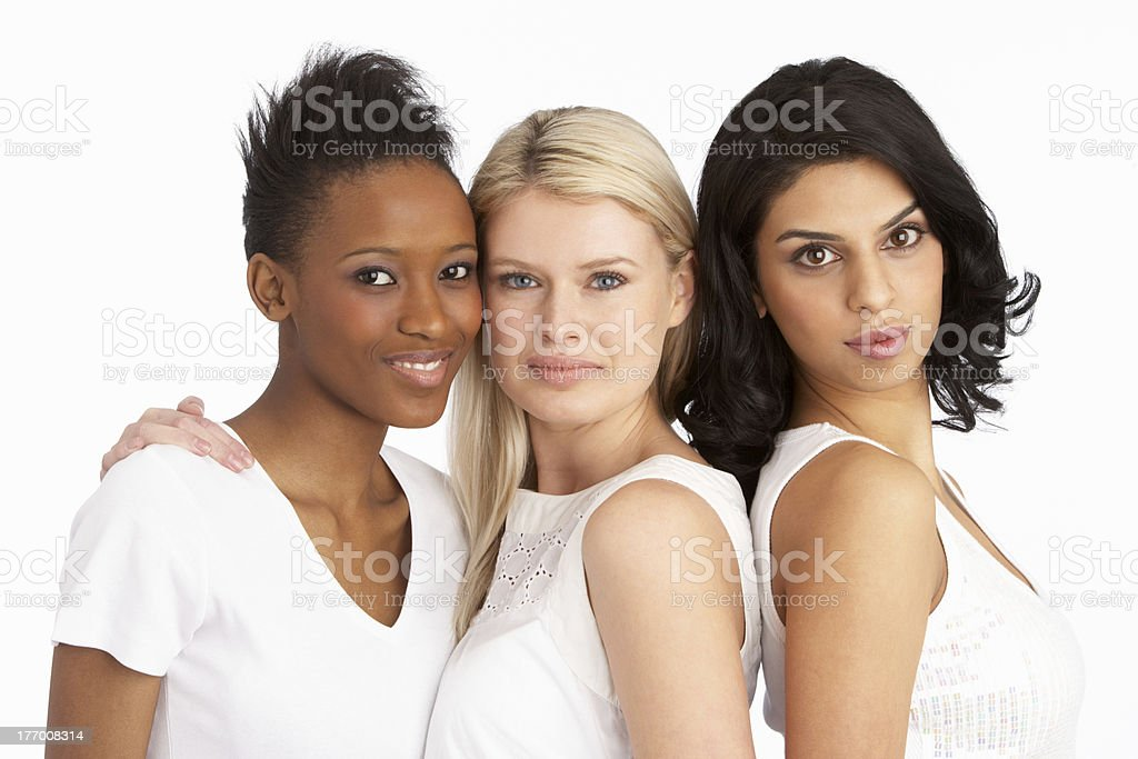 Portrait Of Three Attractive Young Women In Studio stock photo