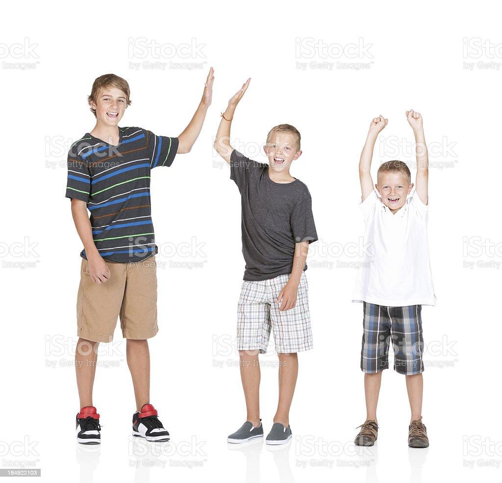 Portrait of three boys cheering stock photo