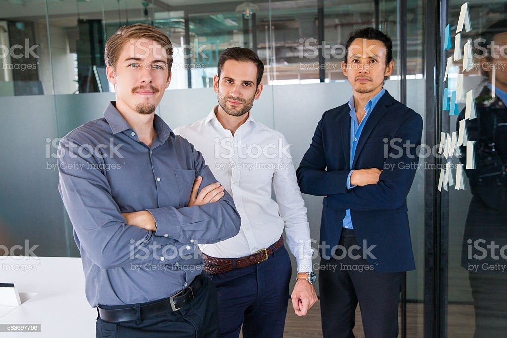 Portrait of Three Businessmen in Office 1 stock photo