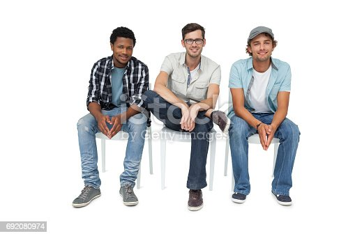 istock Portrait of three cool young men sitting on chairs 692080974