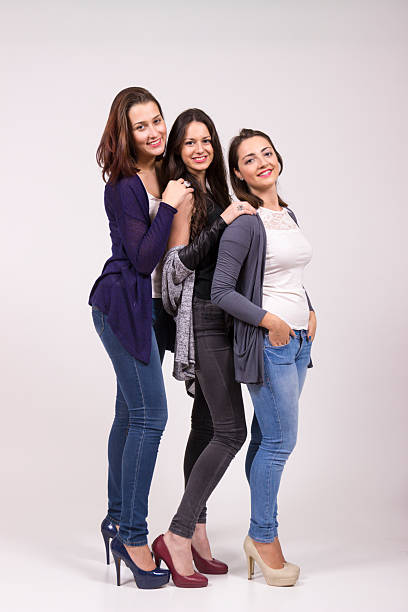 Portrait of three girls, in high heel shoes. stock photo