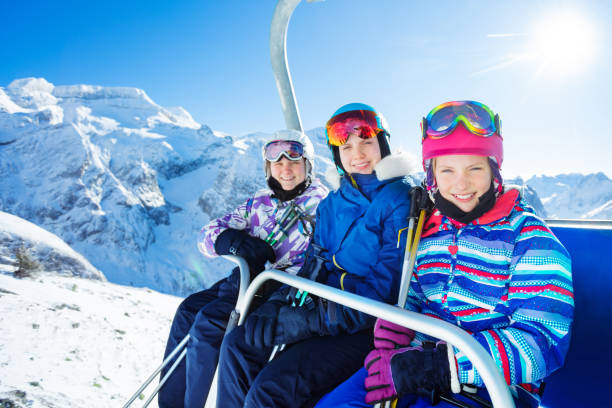 Portrait of three happy girls over mountain top stock photo