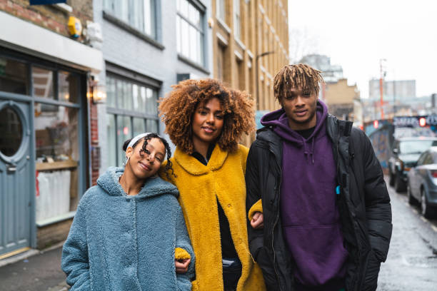 Portrait of three hip friends in the city stock photo