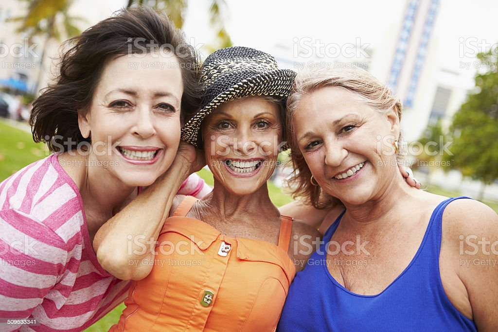 Portrait Of Three Senior Female Friends In Park stock photo