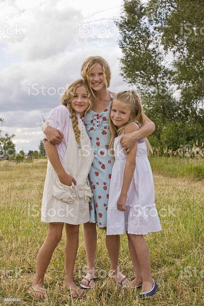 Portrait of three sisters royalty free stockfoto