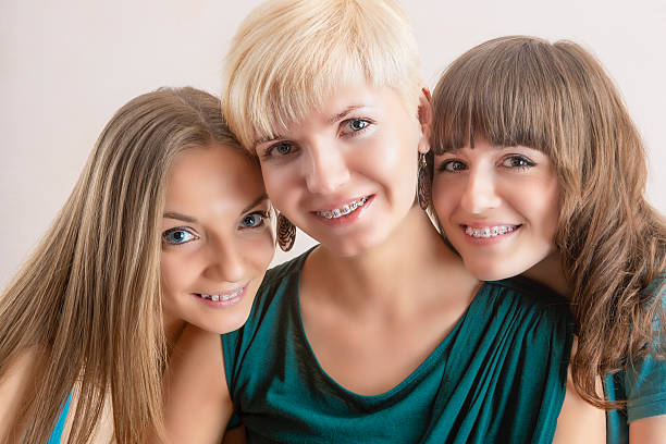 Portrait of Three Young Caucasian Girlfriends With Teeth Braces(Brackets). stock photo