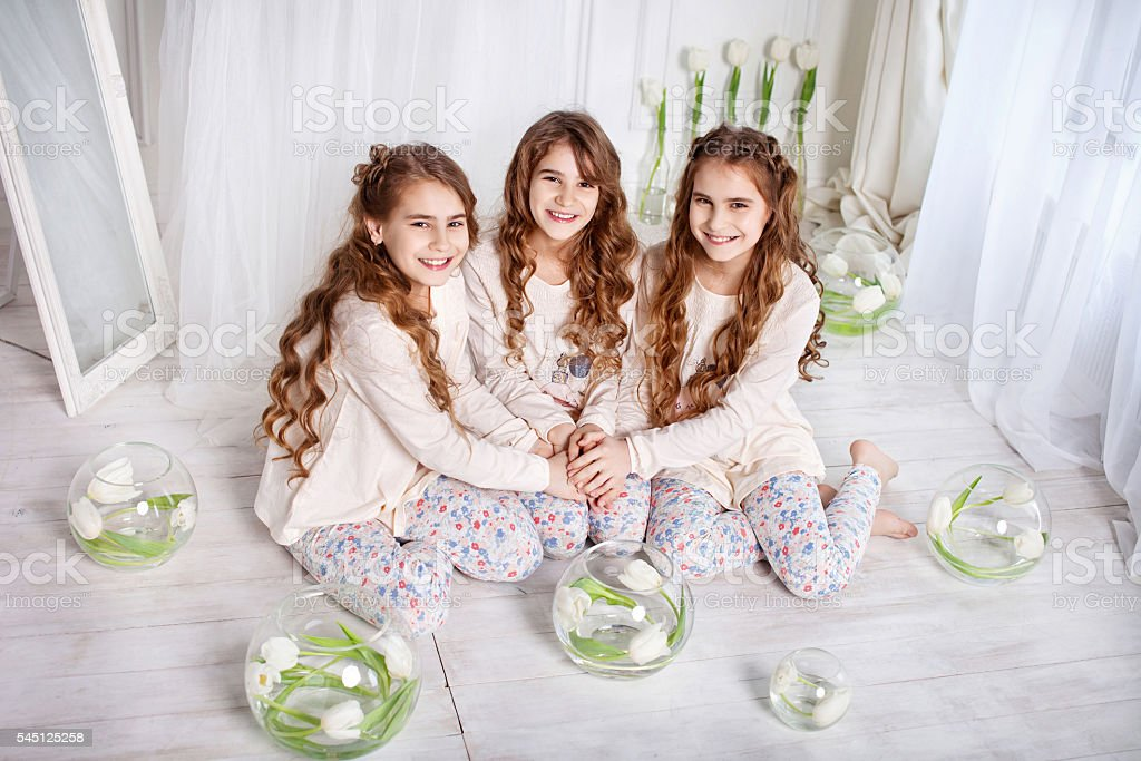 Portrait of three young charming sisters stock photo