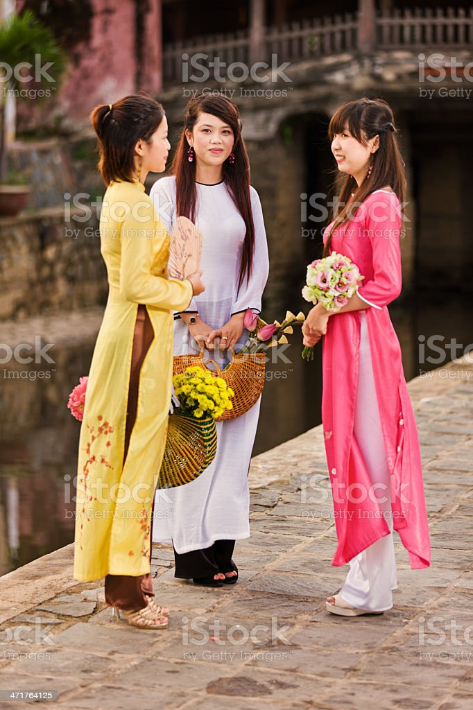 Portrait of three young Vietnamese women wearing ao dai stock photo