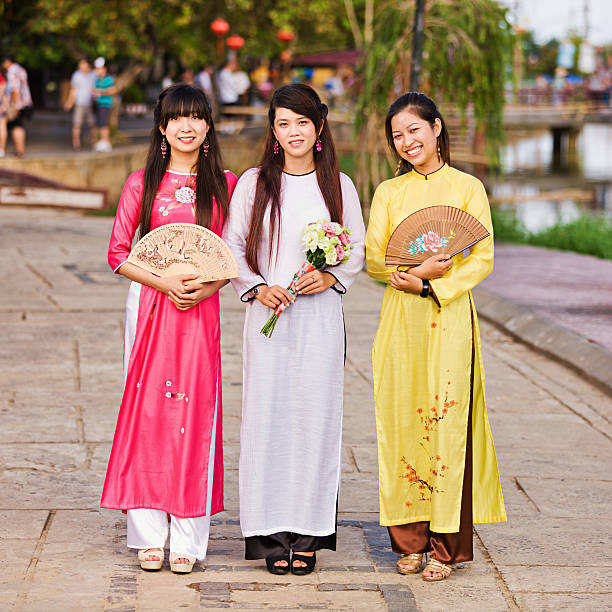 portrait of three young vietnamese women wearing ao dai - ao dai stock photos and pictures