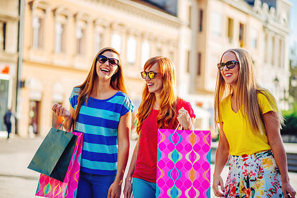 Portrait of three young women after shopping stock photo