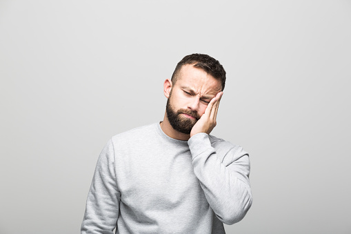 Portrait Of Tired Bearded Young Man Stock Photo - Download Image Now