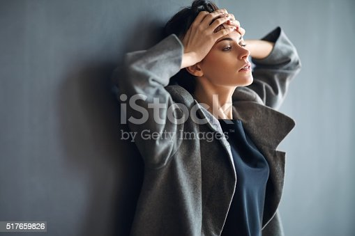 istock Portrait of tired beautiful woman on dark background 517659826