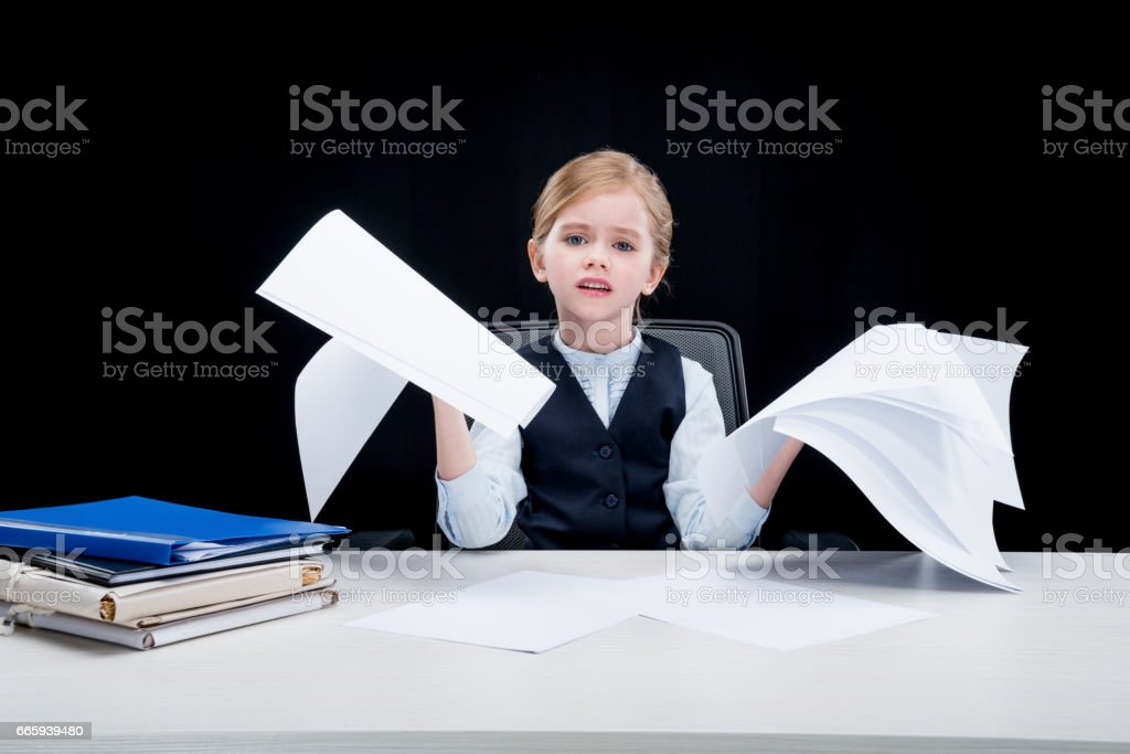 portrait of tired business girl holding papers on black foto stock royalty-free