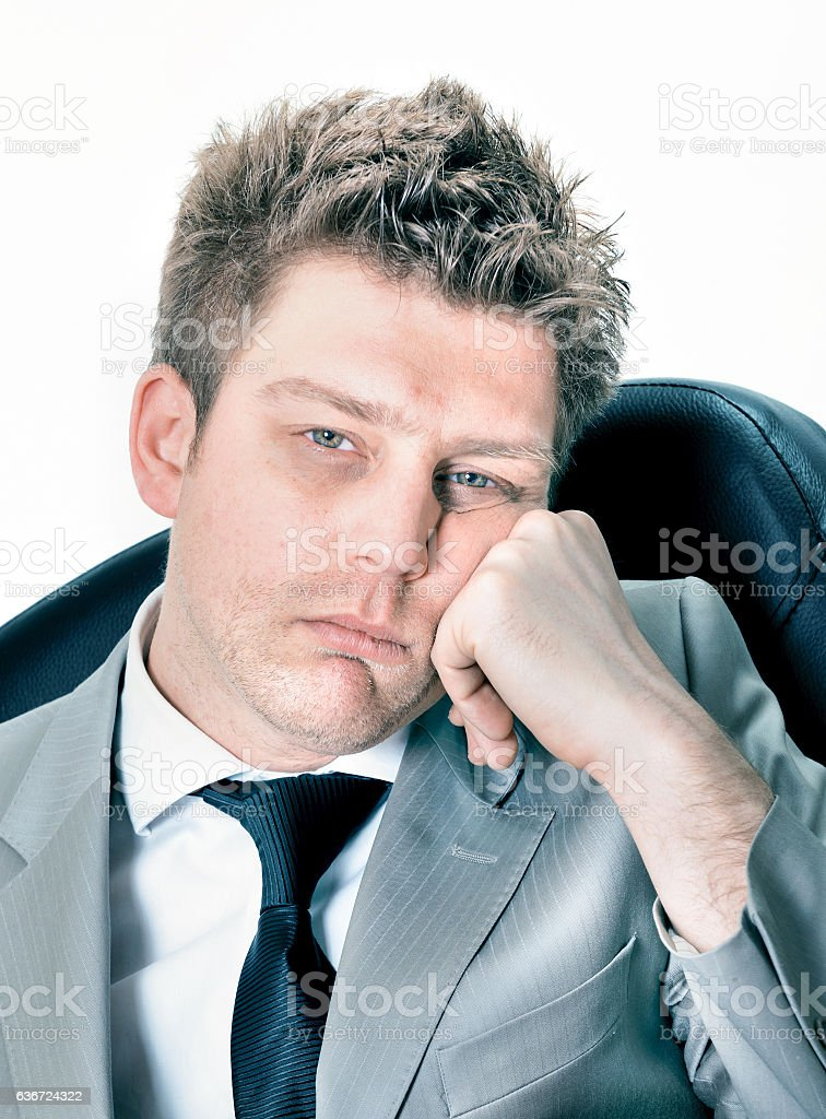 Portrait of  tired businessman at the office stock photo