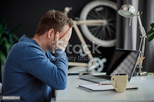 istock Portrait of tired businessman 898958044