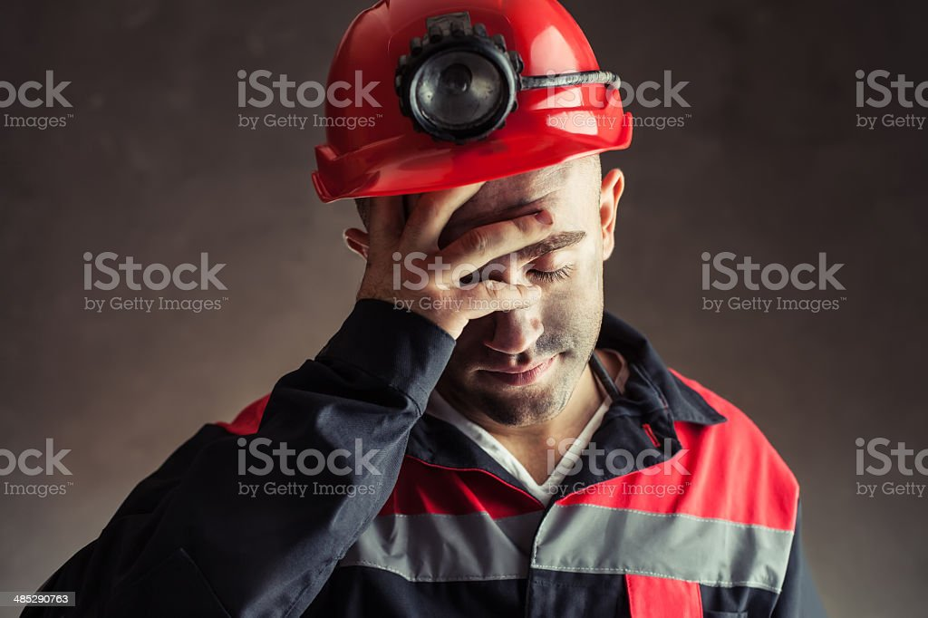 Portrait of tired coal miner stock photo