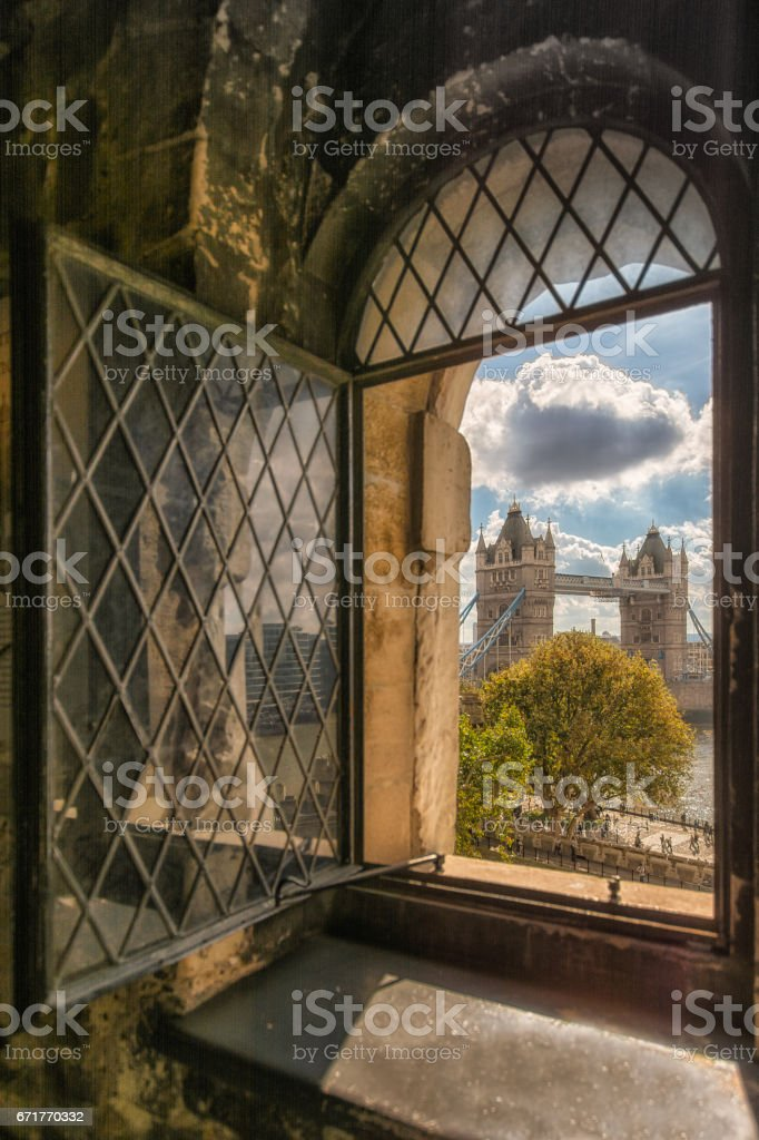 Portrait of Tower Bridge from an old Window at Tower of London stock photo