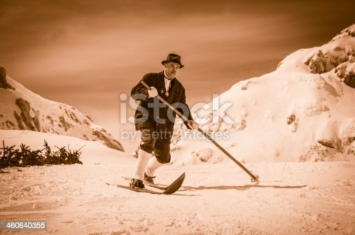 Portrait of a adult skier using equipment from 1950's. One ski pole only. Location: Julian Alps, Slovenia, Europe.Sepia-toned.