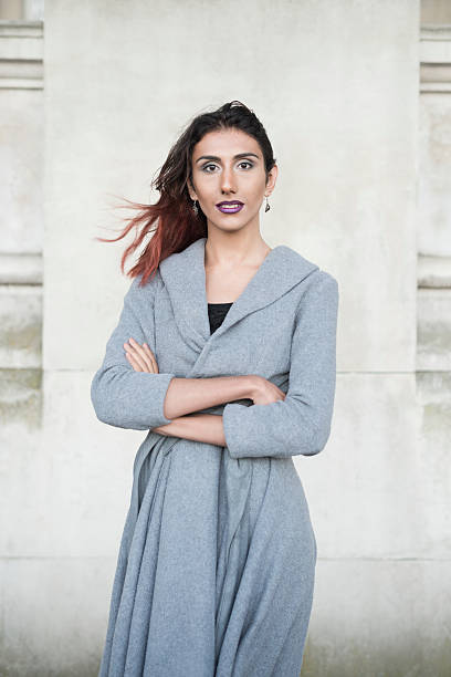portrait of transgender female in grey cardigan, arms folded - transsexual stock photos and pictures