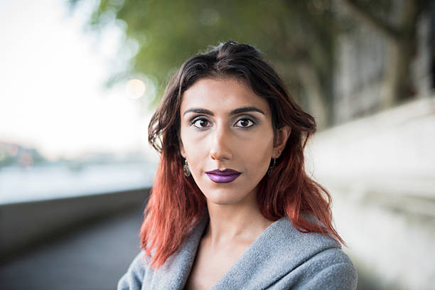 Portrait of transgender female looking towards camera Contented attractive transgender female looking at camera, focus on foreground. Middle Eastern ethnicity. transgender stock pictures, royalty-free photos & images