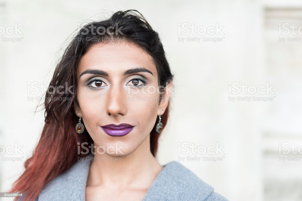 Portrait of transgender female with brown hair and lipstick stock photo