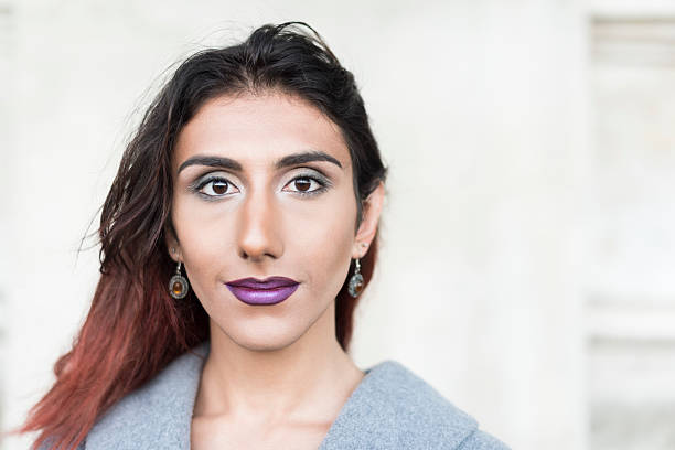 Portrait of transgender female with brown hair and lipstick Attractive Middle Eastern transgender female transgender stock pictures, royalty-free photos & images