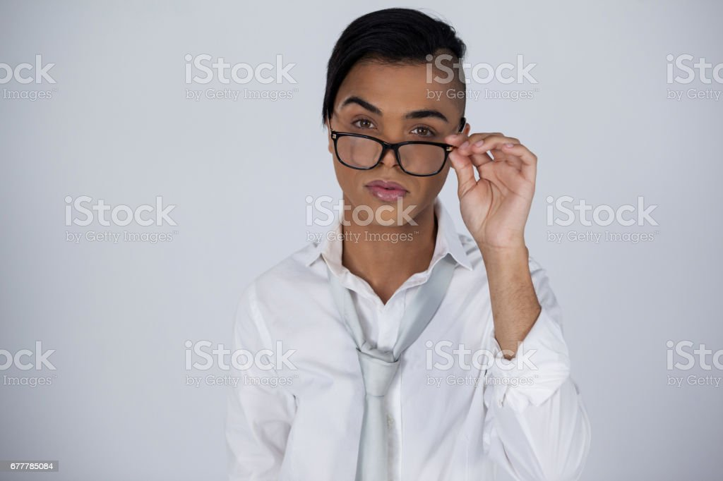 Portrait of transgender woman adjusting eyeglasses royalty-free stock photo