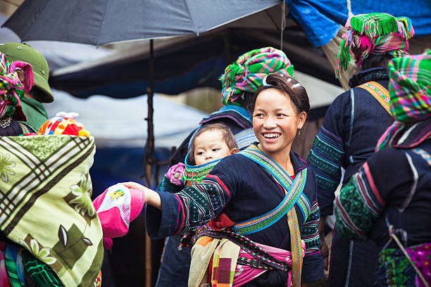 Portrait of tribal Hmong woman with baby, Vietnam stock photo