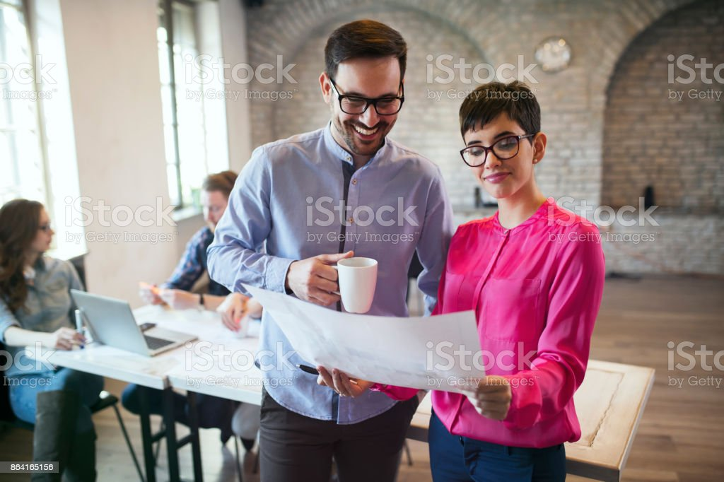 Portrait of two architects looking at project scheme royalty-free stock photo