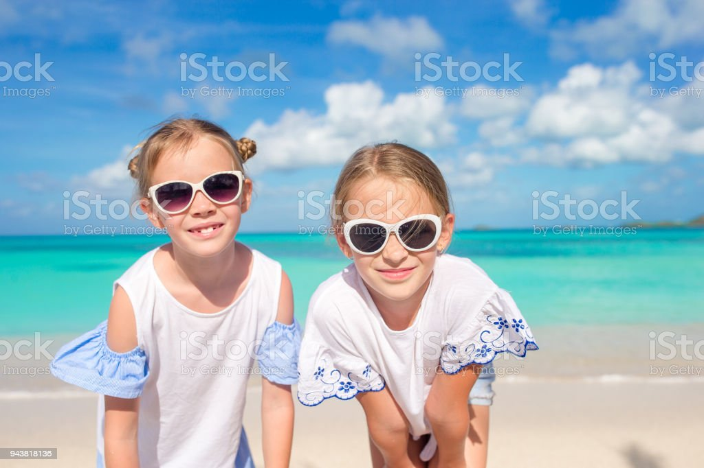 73a5b7edd Portrait Of Two Beautiful Kids Looking At Camera Background Of ...