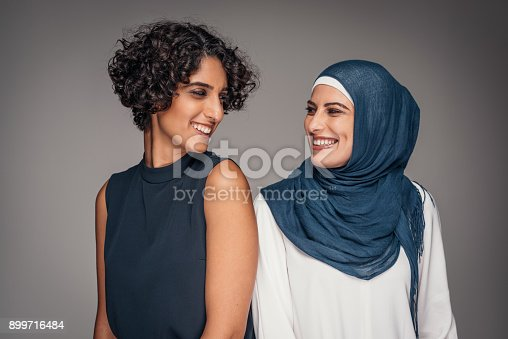 istock Portrait of two beautiful women from Middle East who live and work in Australia 899716484