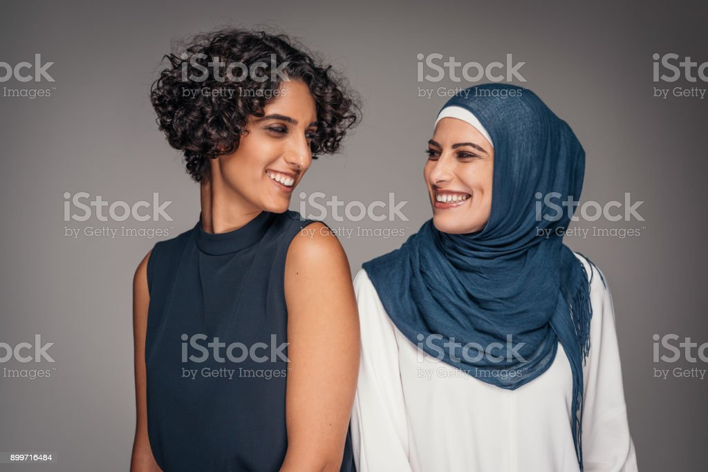 Portrait of two beautiful women from Middle East who live and work in Australia stock photo