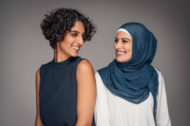Portrait of two beautiful women from Middle East who live and work in Australia Portrait of beautiful women from Middle East. Studio shot of different people who live in Australia and who make Australian nation such a unique and wonderful. global village stock pictures, royalty-free photos & images