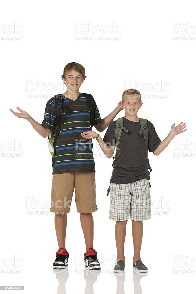 Portrait of two boys gesturing stock photo