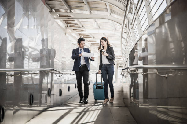 portrait of two business people meeting before go to traveling. business travel concept - business travel stock photos and pictures