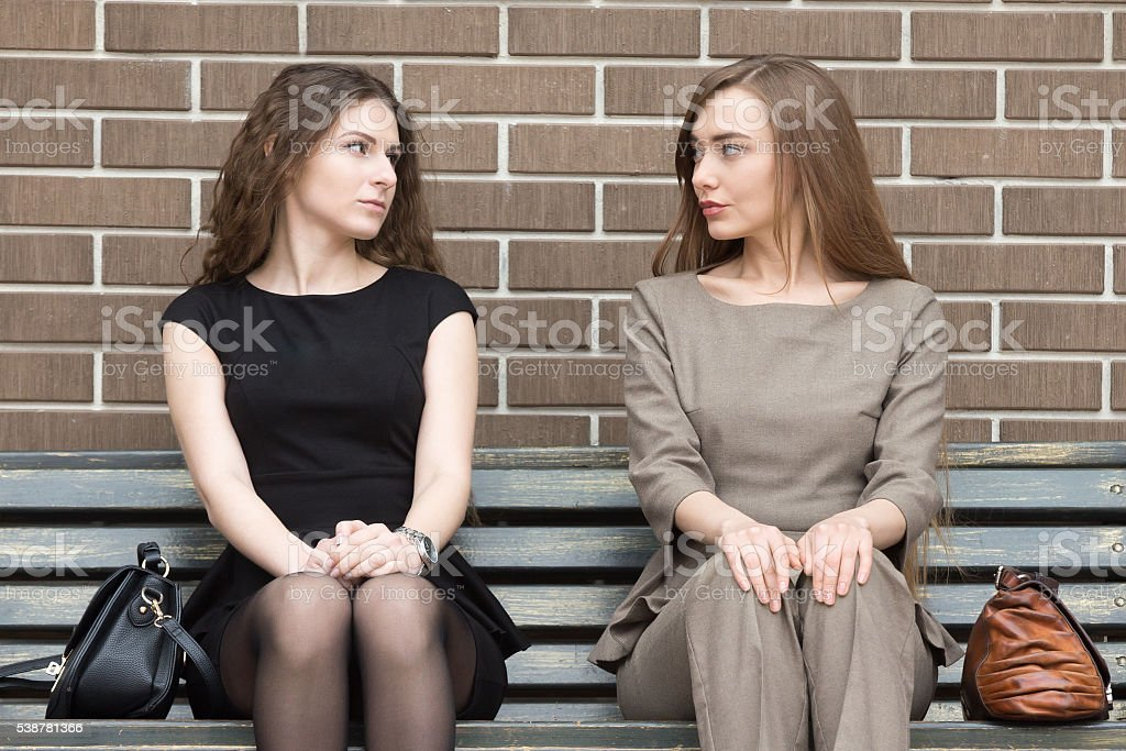 Portrait of two business rivals women looking at each other stock photo