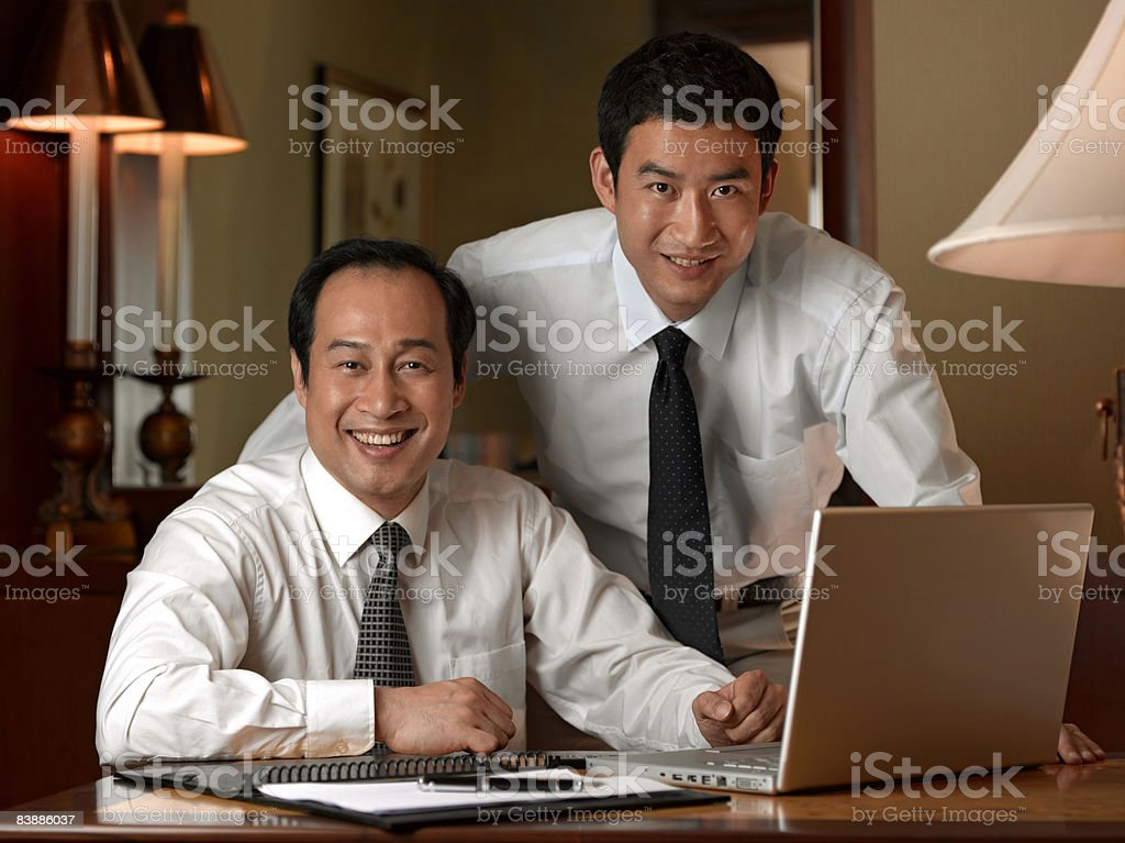 Portrait of two businessmen at laptop. royalty-free stock photo