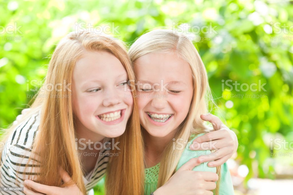 Portrait of Two Caucasian Teenage Girls Laughing and Having Fun stock photo