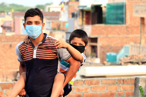 Portrait of two children with pollution mask stock photo