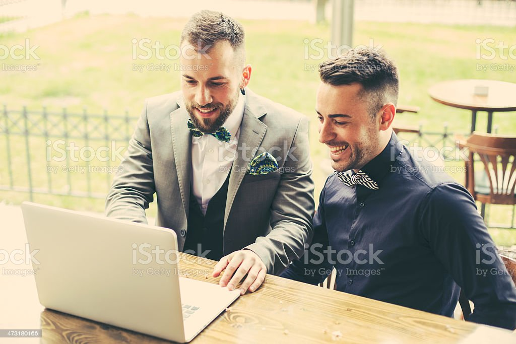 Portrait of two designers discussing a project stock photo