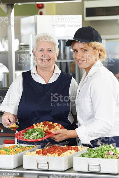 Portrait of two dinner ladies in school cafeteria picture id471490370?b=1&k=6&m=471490370&s=612x612&h=v 07eeijnizx64uqdzpuounw6eea8b  n8ns55q3pto=