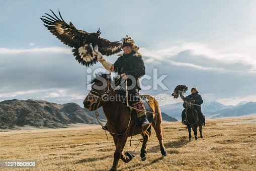 istock Portrait of two eagle hunters near the river in Mongolia 1221850806