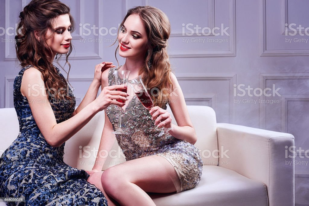 Portrait of two elegant young women with a champagne glasses at celebration stock photo