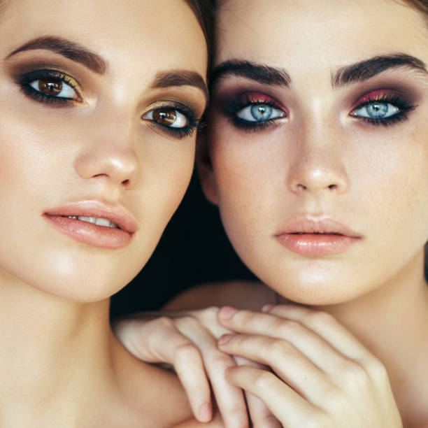 Portrait of two fresh and lovely women Portrait of two fresh and lovely women ceremonial make up stock pictures, royalty-free photos & images